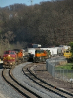 Northbound BNSF High Priority Manifest Passing the BNSF Local Locomotive and Caboose